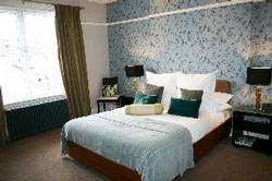Picture of Single Standard With Double Bed & Bathroom Next to the Room